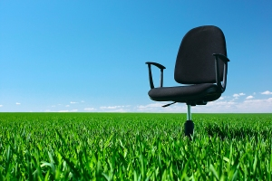 bigstock-Office-chair-standing-on-green-14018252